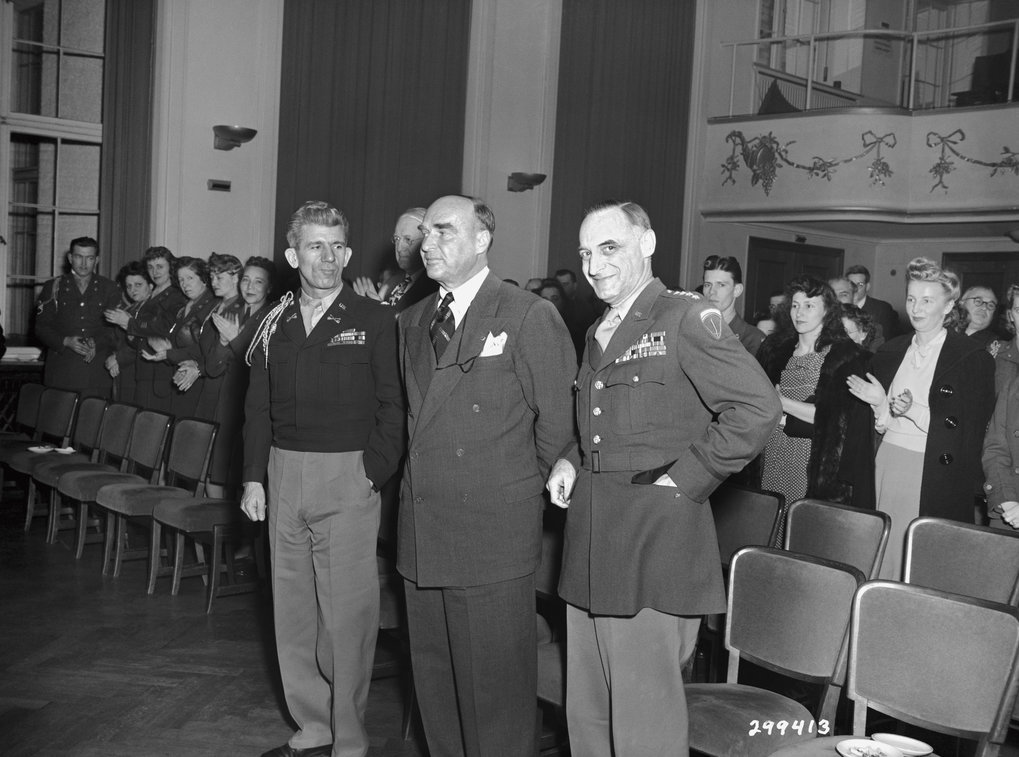 General Lucius Clay (right) with guests at an event in the Goethe Auditorium, 1948.